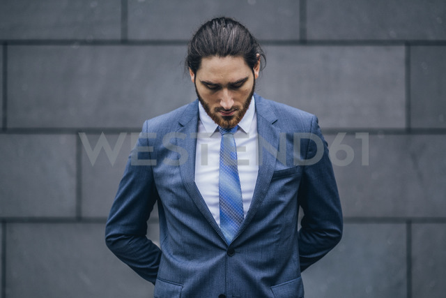 Portrait of serious businessman standing outdoors - JSCF00087