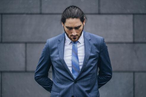Portrait of serious businessman standing outdoors - JSCF00087