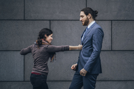Businessman and woman fighting - JSCF00099