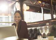 Businesswoman working in restaurant - CAIF16310