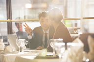 Business people talking in restaurant - CAIF16325