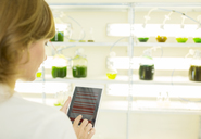 Scientist using digital tablet in laboratory - CAIF16439