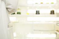 Digital tablet in scientistÕs lab coat pocket - CAIF16445
