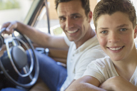 Father and son riding in car together - CAIF16709