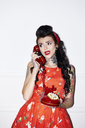 Portrait of tattooed woman with vintage phone - ABIF00133