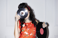 Tattooed woman with records - ABIF00142