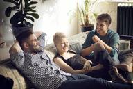 Happy friends enjoying at home - CAVF08412