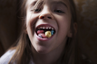 Overhead view of girl eating breakfast at home - CAVF08475