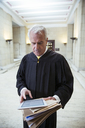 Judge using digital tablet in courthouse - CAIF16849