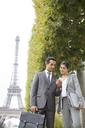 Business people talking near Eiffel Tower, Paris, France - CAIF17012