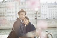 Couple hugging along Seine River, Paris, France - CAIF17021