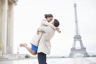 Couple hugging near Eiffel Tower, Paris, France - CAIF17030