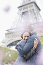 Couple hugging in front of Eiffel Tower, Paris, France - CAIF17033