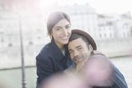 Couple hugging along Seine River, Paris, France - CAIF17042