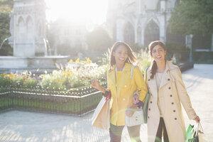 Women walking in urban park - CAIF17048