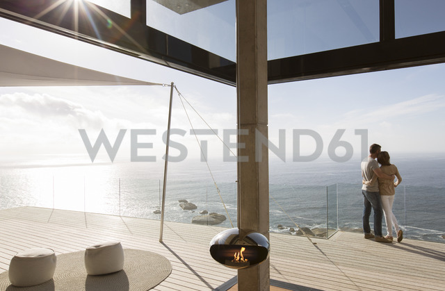 Couple standing on balcony of modern home - CAIF17135 - Astronaut Images/Westend61
