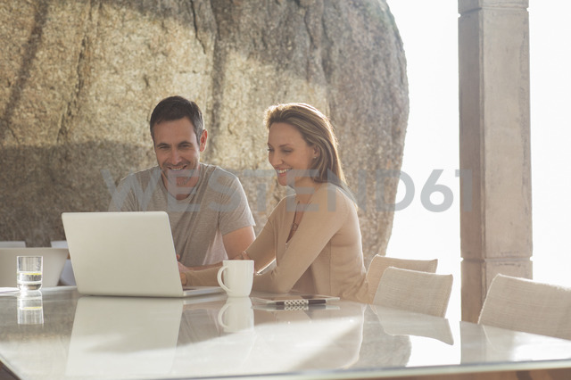 Couple using laptop at breakfast - CAIF17144 - Astronaut Images/Westend61