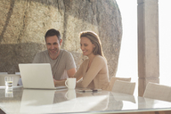 Couple using laptop at breakfast - CAIF17144
