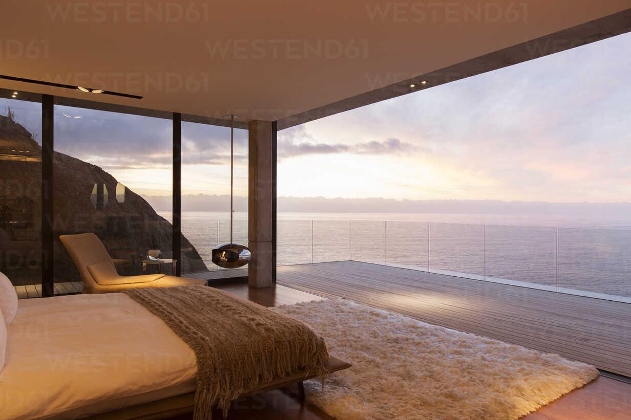 Modern bedroom overlooking ocean - CAIF17174 - Astronaut Images/Westend61