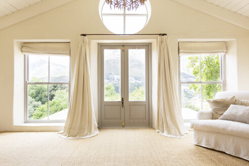 Curtains and front doors of rustic house - CAIF17192