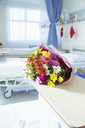 Bouquet of flowers in hospital room - CAIF17417