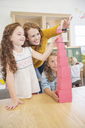 Students and teacher stacking blocks in classroom - CAIF17456