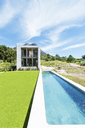 Modern swimming pool under blue sky - CAIF17543