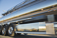 Blurred view of stainless steel milk tanker on the move - CAIF17573
