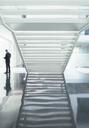 Businessman in modern lobby - CAIF17603