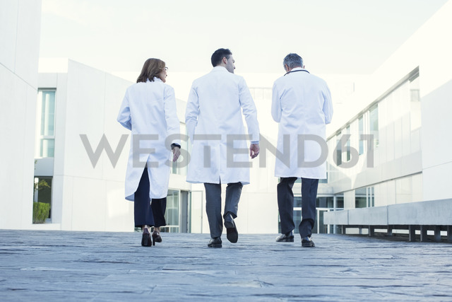 Doctors walking on rooftop - CAIF17618