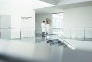 Doctors talking in hospital corridor - CAIF17627