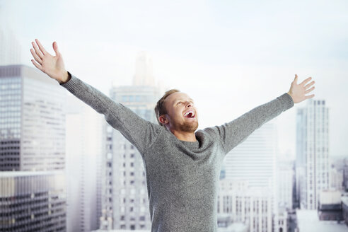 Exuberant man in urban window - CAIF17633