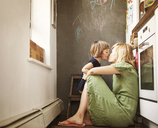 Daughter kissing mother at home - CAVF09187