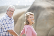 Older couple walking outdoors - CAIF18068