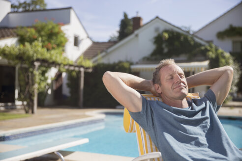 Man relaxing at poolside - CAIF18152