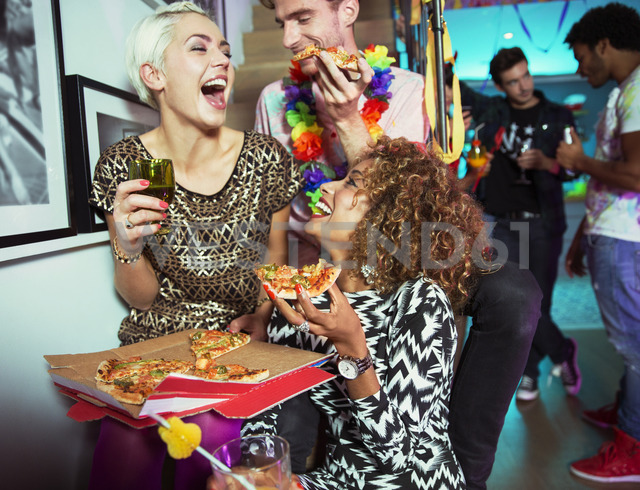Friends eating pizza at party - CAIF18191