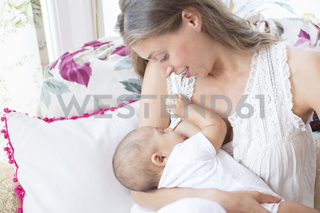Mother breast-feeding baby boy - CAIF18218