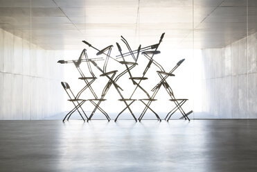 Silhouette of office chair installation art - CAIF18284