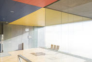 Chairs and window in sunny office lobby - CAIF18302