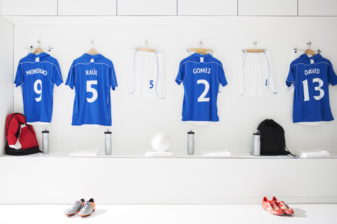 Soccer team uniforms in locker room - CAIF18326