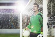 Goalie holding ball on soccer field - CAIF18350