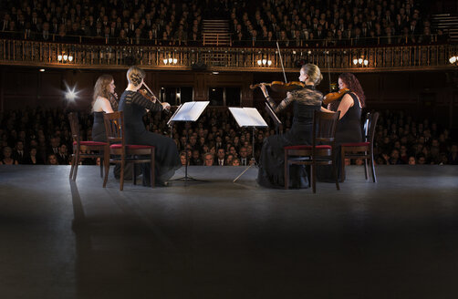 Quartet performing on stage in theater - CAIF18383