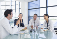 Doctors and business people talking in meeting - CAIF18516