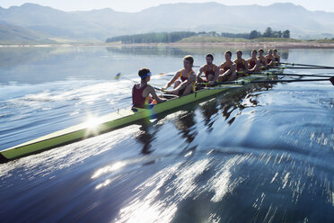 Rowing team rowing scull on lake - CAIF18636