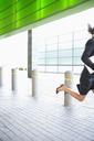 Businesswoman running - CAIF18639