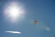 Austria, Salzkammergut, Hot air balloon oin the sun - STCF00392