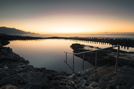 Spain, Canary Islands, Gran Canaria, Puerto de las Nieves, natural pool at sunset - STCF00437