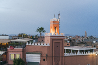 Morocco, Marrakesh, view to Jemaa el-Fnaa, tower in the evening light - TAMF00966