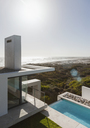 Modern house and lap pool overlooking ocean - CAIF18807