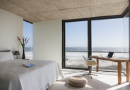 Modern bedroom overlooking ocean - CAIF18813